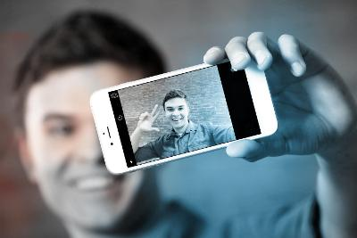 Image of young man taking a selfie
