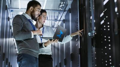 Image of two work colleagues looking at a network server