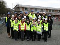 Image of pupils and people outside Welshpool Church in Wales Primary School