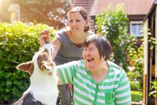 Lady with learning disabilities with carer and dog
