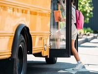 Image of a child stepping onto a bus