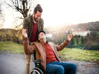 Carer and father in wheelchair