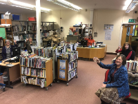 Image of Newtown Area Library staff celebrating