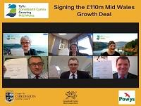 Image of English screengrab of people signing Heads of Terms or Mid Wales Growth Deal