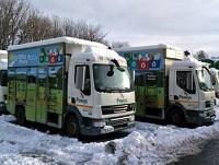 Image of Powys recycling lorries in the snow
