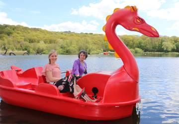 Image of 2 ladies sat in a dragon boat on Llandrindod Lake