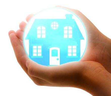 Image of hands holding a glowing house