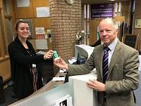 Image of Cllr Stephen Hayes receiving a 'Message in a Bottle'
