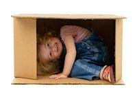 Image of a child in a cardboard box