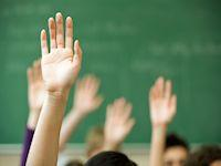 Images of hands in the air in a classroom