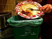 Image of food waste going into a food bin