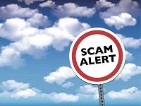 Image of an English scam warning logo