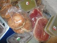 Image of raw meat and ready to eat food stored together in freezer