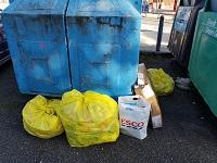 Image of fly-tipping outside a recycling bank