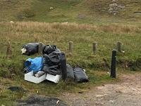 Image of fly-tipping on a road layby