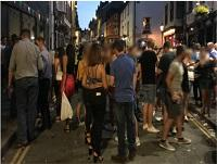 Image of people standing in street in Builth Wells