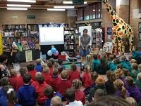 Image of primary school pupils listening to children's author Tracey Corderoy