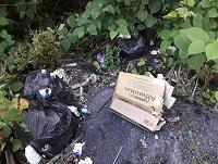 Image of rubbish fly-tipped in a layby